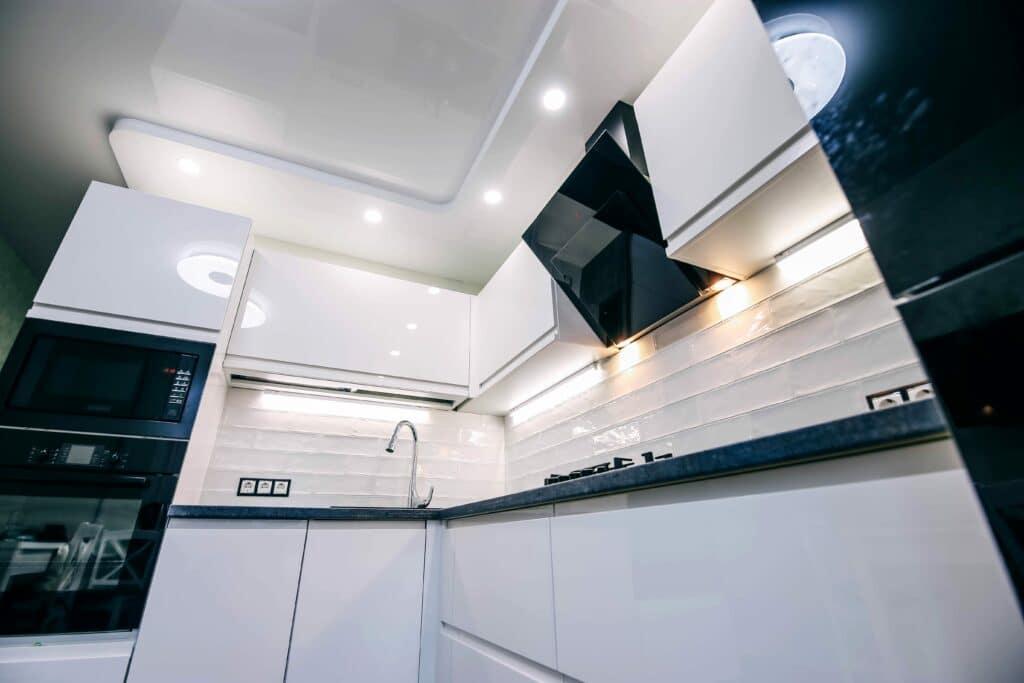 LED lighting modern kitchen. Suspended glossy ceiling.